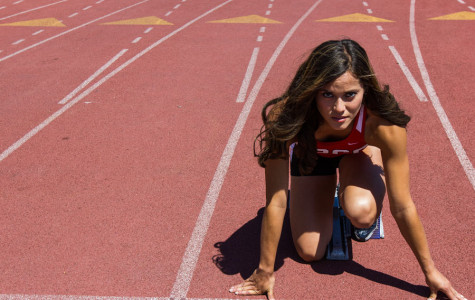 City College's freshman track and field athlete, Jessica Escalante, sets her position on the starting blocks on Friday, April 11, at La Playa Stadium in Santa Barbara. Escalante, 19, recovered from three knee surgeries to become a sprinter and javelinist on the team.