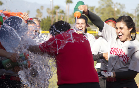 The team celebrates the victory by showering head coach Paula Congleton with water after winning both games against Moorpark College on Tuesday, April 22, at Pershing Park. The Vaqueros won, 6-2 and 7-0, and finished the regular season with an overall record of 22-14.