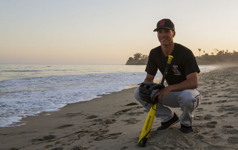 City College outfielder Connor McManigal, 19, takes a look at the surf after baseball practice on Tuesday, April 15, at Leadbetter Beach in Santa Barbara. McManigal has served as a Santa Barbara lifeguard in the past summers and leads the Vaqueros with a .326 batting average this season.