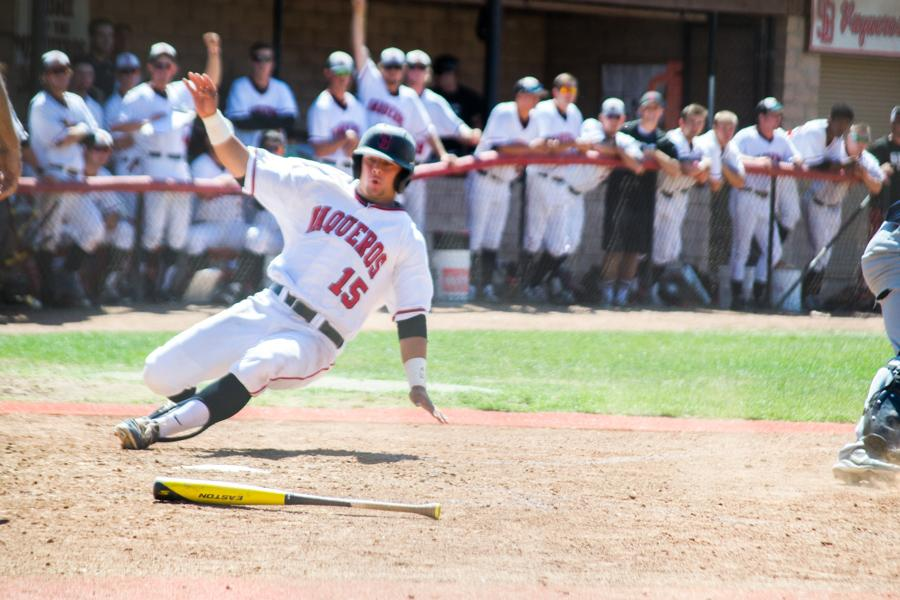 Designated hitter Jimmy Hill (No. 15) slides safely into home in the first game of the Super Regional series against LA Mission, Friday May 10, at Pershing Park. The Vaqueros defeated the Eagles, 3-0, and are one win away from moving on to Sectionals.