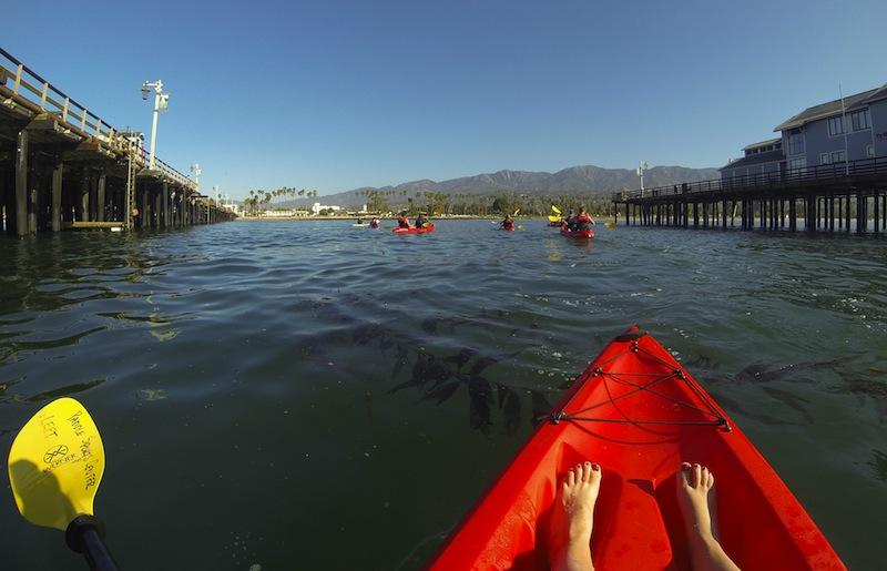 The City College Kayakers paddle underneath Stearns Wharf, Thursday, April 24, in Santa Barbara. The Kayaking class meets Tuesdays and Thursdays from 8:00 to 10:00 am to paddle out on the ocean.
