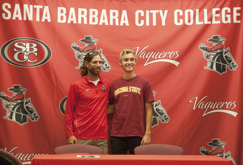 Cross Country Runner Ian Roberts shares a moment with coach Scott Fickerson after signing his letter of intent to Arizona State University, Thursday, May 8, at the Sports Pavilion. Roberts was named the 2013-2014 Male Athlete of the Year.