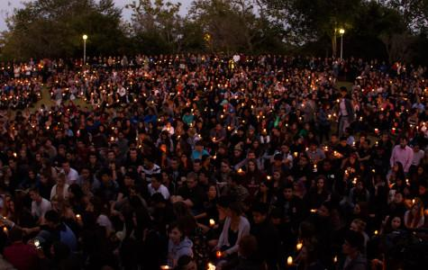 Students and community members share their thoughts on the Isla Vista shooting during the vigil on Saturday, May 24, 2014, at Anisqovo Park in Isla Vista, Calif.