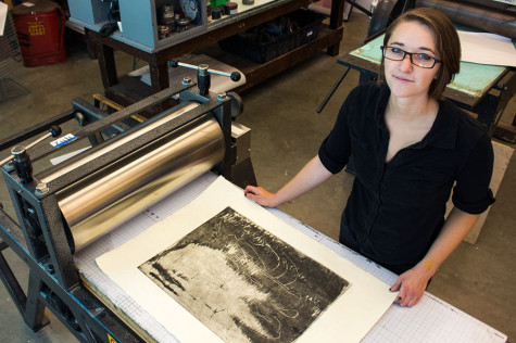 "Sasha Colbert, 22, shows a print of her etching, ""Staying Late,"" on an etching press on Wednesday, May 7, in the screen printing lab of the Humanities Building at City College in Santa Barbara, Calif. Colbert won three awards, including the President's Purchase Award, at the Annual Student Exhibition in the Atkinson Gallery for the original etching."