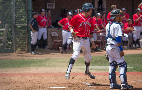 City College's freshman outfielder, Brandon Evans (No. 14), celebrates earning a run after Patrick O'Brien's double base hit during the fourth inning on Saturday, May 3, at Pershing Park in Santa Barbara. The Vaqueros defeated the San Bernardino Valley College Wolverines 8-2, advancing to the second round of the 2014 CCCAA Baseball Southern California Regional for the second time in school history.