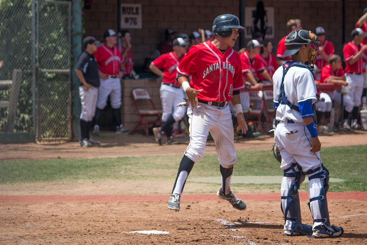 City College's freshman outfielder, Brandon Evans (No. 14), celebrates earning a run after Patrick O'Brien's double during the fourth inning on Saturday, May 3, at Pershing Park in Santa Barbara. The Vaqueros defeated the San Bernardino Valley College Wolverines 8-2, advancing to the second round of the 2014 CCCAA Baseball Southern California Regional for the second time in school history.