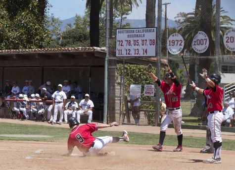 Jimmy Brakka (No. 9) slides in safely to home as Patrick O'Brien (No. 27) and Brandon Evans (No. 14) wait to congratulate him, Saturday May 10, at Pershing Park. The Vaqueros' 8-1 win against LA Mission in game two of the best-of-three series advances them to the Sectionals round for the first time in program history.