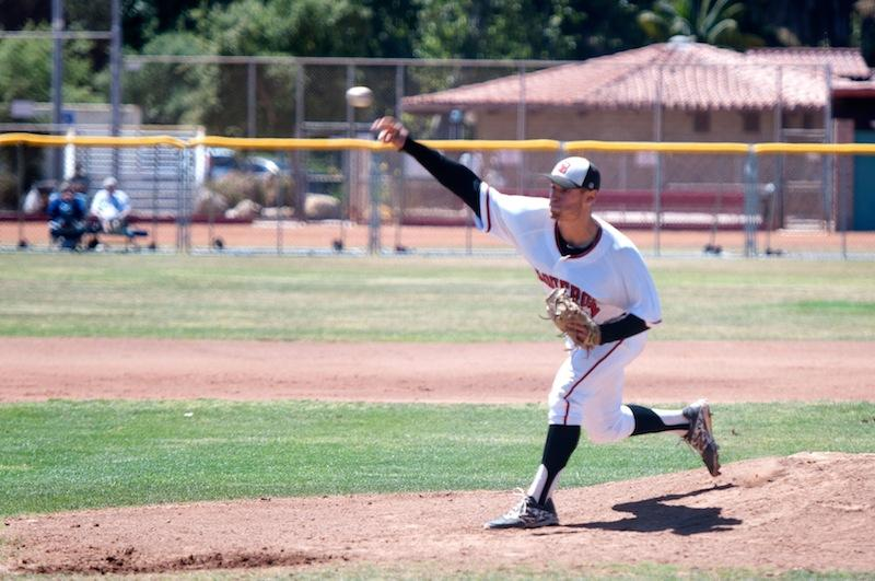 Vaqueros' starter Justin Bruce (No. 11) delivers a pitch in the third inning of the first game against LA Mission College, Friday, May 9, at Pershing Park. Bruce pitched eight innings, shutting out the Eagles, en route to a 3-0 City College victory.