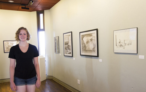 Ryan Peters curates the shows in the Annex Gallery, one of her duties as gallery intern for the art department, Wednesday, Sept. 17, on East Campus in Santa Barbara. 'I like to work in the gallery because I love to share my enthusiasm for art with other people,' said Peters.