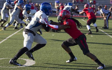 Vaquero defensive back Detavius Long (No. 3) holds off Wolverine wide receiver Darian Barrientos-Jackson (No. 9) in the 60th season opener against San Bernardino Valley College on Saturday, Sept. 6, at La Playa Stadium. City College lost against the Wolverines 18-10.