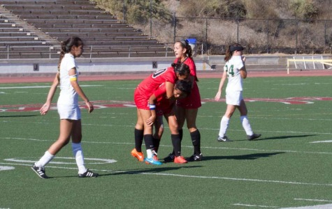 Santa Barbara City College forward Laura Romero (No. 20) and defender Mackenzie Rios (No. 10) celebrate with forward Sandy Grimaldo (No. 13) after Grimaldo's game winning goal in the 91st minute of the Vaquero's 1-0 victory Friday, Sept. 26 over the Los Angeles Valley College Monarchs