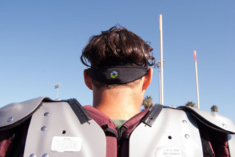 Timmy Milliken (No. 48) and teammates wear the Triax headbands, a new method being used at City College to track head impact data and flag the coach on forceful impacts, at practice Monday, Sept. 15, at La Playa Stadium.