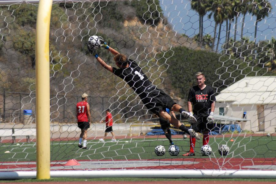 City College goalkeeper Tristan Cooper (No. 1) defends the goal from a teammate during practice on Tuesday, Sept. 2, at La Playa Stadium. The men's team finished second in the Western State Conference last season.