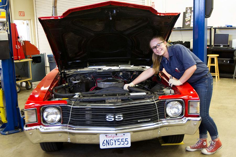 Kianna Silva, 18, in the Automotive Department with a 1972 Chevelle, Wednesday, Oct. 7, at City College in Santa Barbara. Silva is pursuing her associate degree in Automotive Service and Technology.
