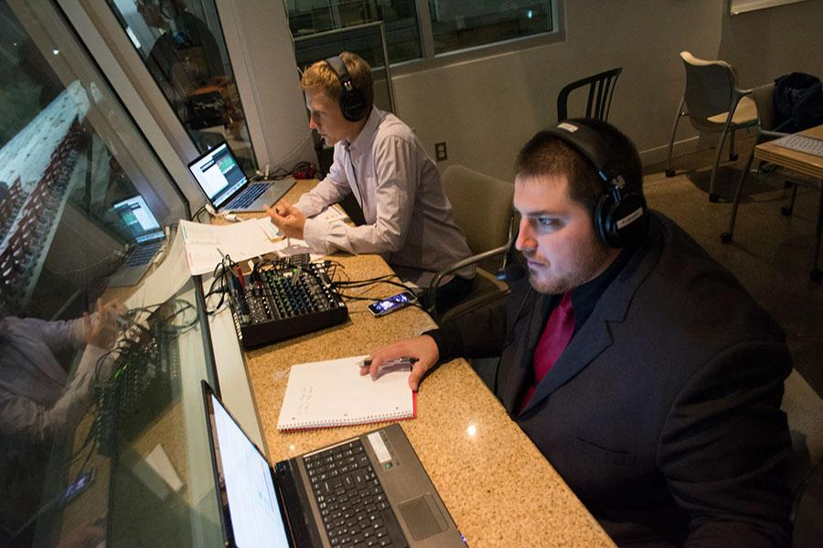Broadcaster Ryan Graff (right), former Director of Broadcasting at Occidental College, and color analyst Sam Fielding, look out over La Playa Stadium during a live broadcast of a Vaquero's men's soccer game, Tuesday night, Oct. 7, in Santa Barbara, Calif. Graff joined the Santa Barbara City College Athletic Department for the 2014-2015 school year to be the lead play-by-play voice of the Vaqueros and Assistant Sports Information Specialist.