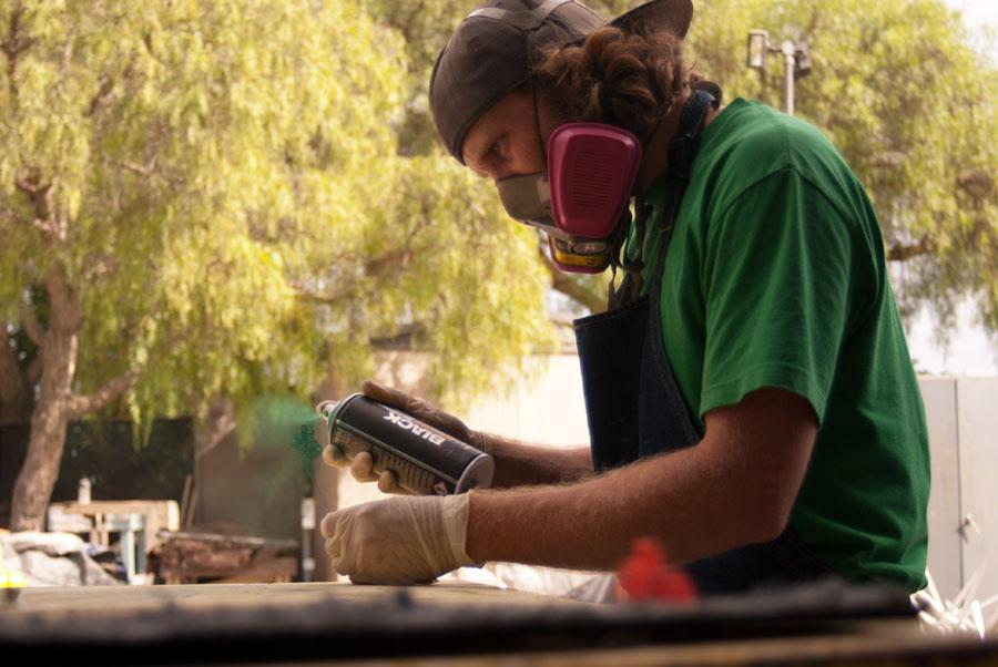 City college art student, Ben Eckert, uses his new green spray paint to paint his sculpture on Wednesday, Oct. 15, in Santa Barbara, Calif. Eckert said,