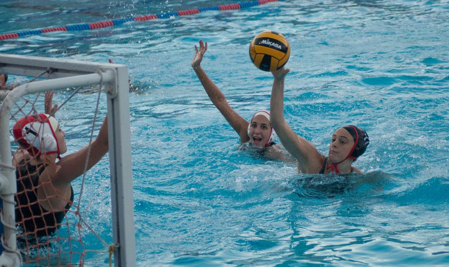 City+college+women%27s+waterpolo+utility+player%2C+Abdiel+%22AJ%22+Gravatt+%28No.17%29+scores+against+Pierce+College+goalie+Sarah+Karp+%28No.1%29+and+field+player+Isabella+McNealy+%28No.6%29+during+the+game+at+San+Marcos+High+School+in+Santa+Barbara%2C+Calif.+on+Wednesday%2C+Oct.+22%2C+2014.+The+Vaqueros+beat+the+Brahmas+12-6.