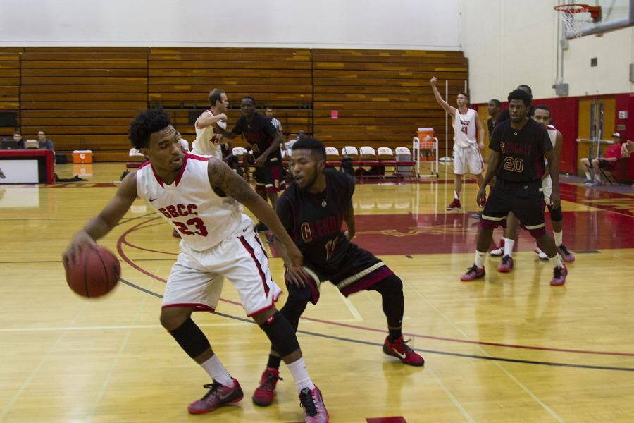 Santa Barbara City College sophomore point guard and returning starter Alonzo McCain (No. 23) shields off a defender at Santa Barbara City College, Calif. Tuesday, Nov. 25. McCain ended the game with 3 points, 3 rebounds and 6 assists.