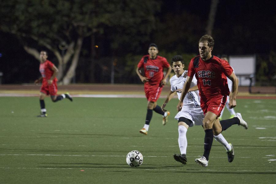 Santa Barbara City College defender Albi Skendi (No. 14) takes the ball down the pitch during the Vaqueros game against LA Mission Tuesday, Nov. 4 at La Playa Stadium in Santa Barbara, Calif.  Skendi scored the second goal in the final minute of play to tie the game.