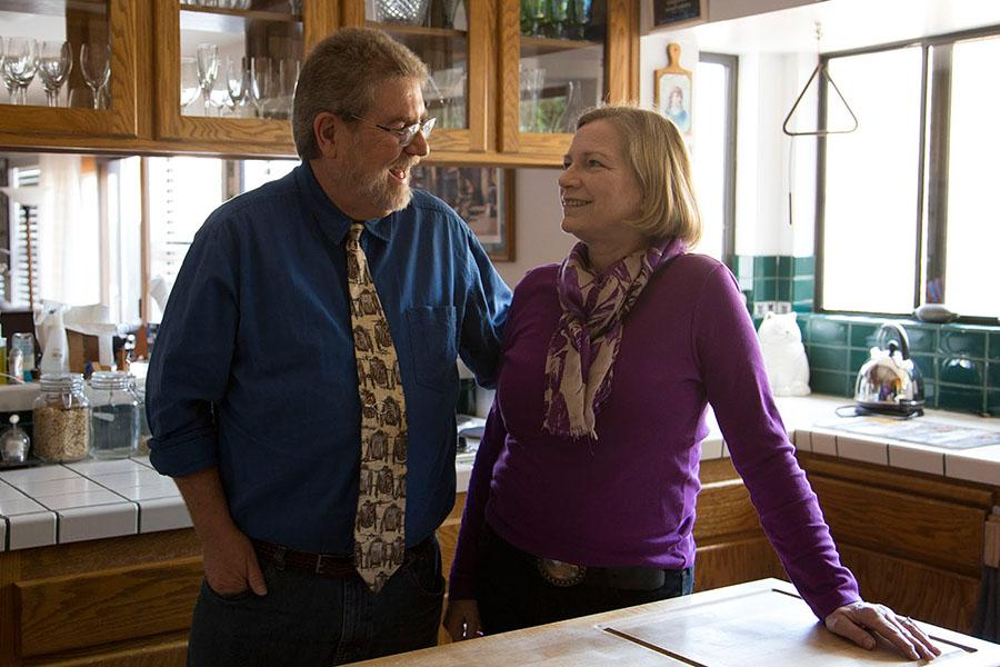 """Michael Gros, associate theatre professor at City College, and his wife Kris Gros, on Sunday, Nov. 2, in the kitchen of their home in Arroyo Grande, Calif. The couple has been together since 1988. """"I wouldn't be with him after all these years if I didn't think he was a good person,"""" said Kris."""