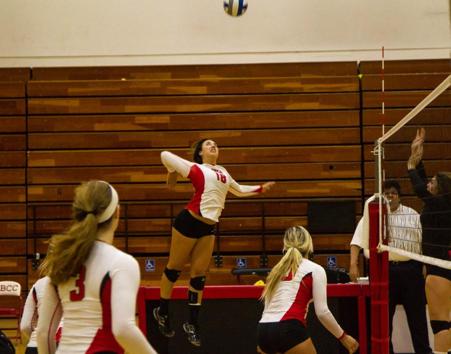 Vaquero outside hitter Katelynn Womack (18) prepares to spike the ball during a volley in the second set of the Santa Barbara City College Women's Volleyball match against the Ventura College Raiders Wednesday night Nov. 12 at Santa Barbara City College, Santa Barbara, Calif. SBCC's 3-0 route of the Raiders gave head coach Ed Gover his 300th career victory.