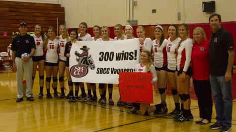 Ed Gover (black), head coach of the Santa Barbara City College Women's Volleyball team, and his team celebrate Gover's 300th career win Wednesday night Nov. 12, after the Vaquero's defeated the Ventura College Raiders 3-0 at Santa Barbara City College, Santa Barbara, Calif.