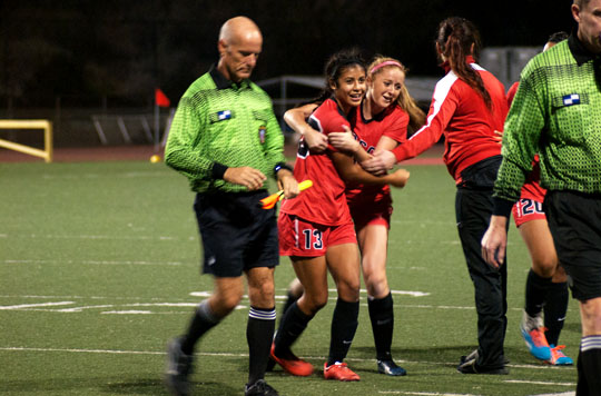 City College forwards, Sandy Grimaldo (No.13) and Michelle Day (No.2) celebrate after winning the womens soccer conference game on Tuesday, Nov. 11, at La Playa Stadium in Santa Barbara. The Vaqueros beat the Pirates 3-0.