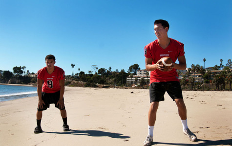 City College running back Cedric Cooper (left) and quarterback Brandon Edwards set up to do a quick handoff at Leadbetter beach, Wednesday, Nov. 5, in Santa Barbara, Calif. The two athletes embrace the sunny beach, coming from Seattle, Wash.
