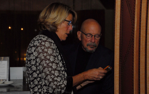 Lori Gaskin and Elliot Schuman check updated results on Measure S at Cielito Restaurant in Santa Barbara, Tuesday, Nov. 4. Measure S failed to receive the 55 percent needed to pass.