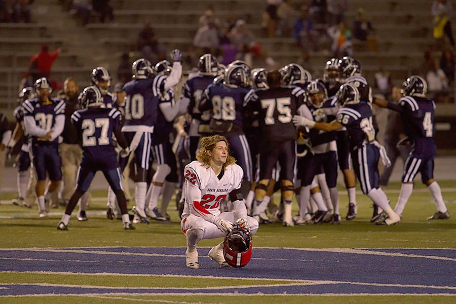 City College's Tyler Higby (No. 22) crouches down seconds after losing to Cerritos College in the Golden State Bowl on Saturday, Nov. 22 in Norwalk, Calif. The Vaqueros could not hold on to the lead in the closing minutes of the game losing 22-19.