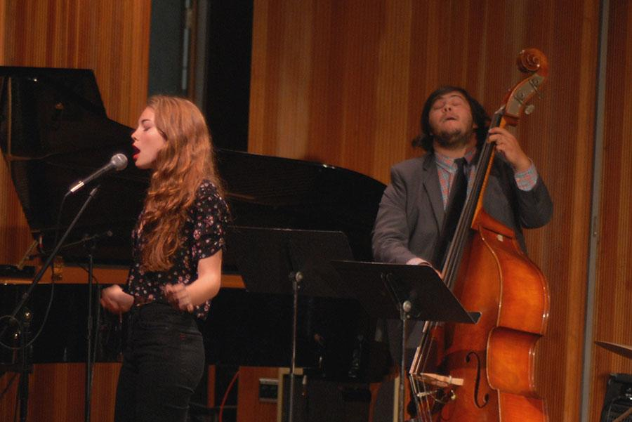 """The Anna Casper Quartet played one song during their set on Saturday, Nov. 1, performing at the Fall Chamber Jazz Concert in the City College Fé Bland Forum. Vocalist Anna Casper sings """"Desafinado"""" while Sebastian Martinez accompanies her on the bass."""