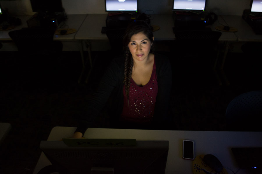"""Electrical Engineering major Abigael Orozco spotted in the CS lab in the Humanities Building on East Campus, finishing up a project before finals week, Thursday, Dec. 4, 2014. Says Orozco, """"I never saw myself going into Electrical Engineering, but I loved my math and science classes so much that it just felt right."""""""
