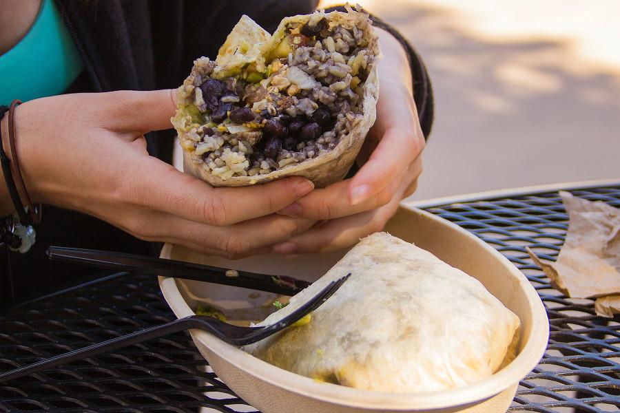A burrito with chicken, brown rice, black beans, caramelized onions, lettuce, pico de gallo and guacamole, Tuesday, Feb. 24, at City College's Favela Burrito Shack on East Campus.