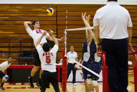 Keaton Arutian (No. 5) sets up the ball for City College middle blocker Jeremy Burch (No. 16) to hit and score a point during the third set, Wednesday, Feb. 11, in the Sports Pavilion at Santa Barbara City College. The Vaqueros won 3-2 against Irvine Valley College.