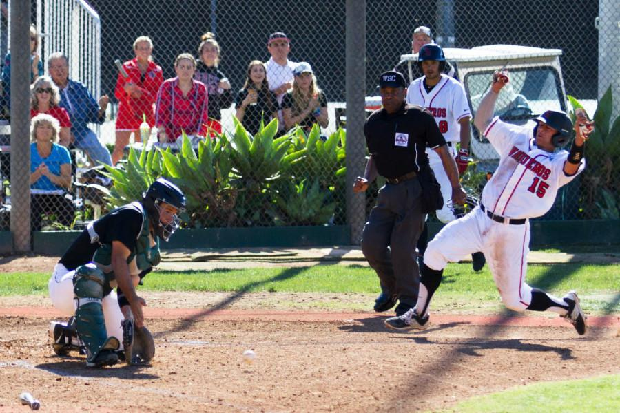 City College catcher James Hill (No. 15) slides in to score a run against Cuesta College, Tuesday, Feb. 24, at Pershing Park in Santa Barbara. The Vaqueros beat the Cougars 4-0.