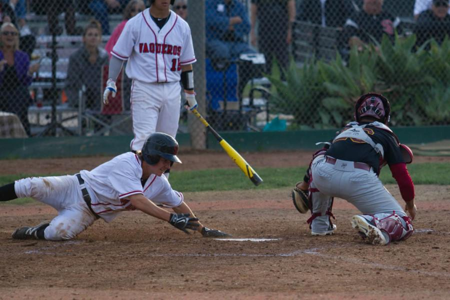 Spencer Erdman (No. 5) slides into home on a wild pitch, tying the game 4-4 against Glendale, Thursday, Feb. 5th, 2015, at Pershing Park in Santa Barbara, Calif. After extra innings, the City College went on to beat Glendale 6-5.