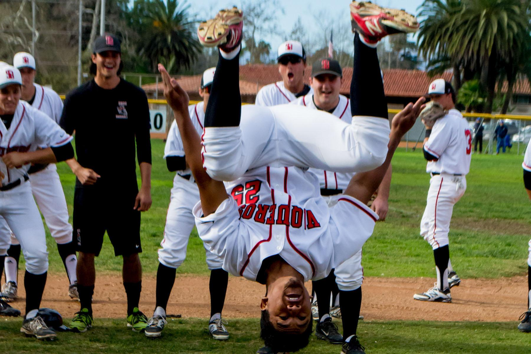 Vaquero's outfielder Cameron Jones (No. 25) performs his pre-game ritual of doing backflips to get the team pumped up before the game, Friday, Jan. 29, at Pershing Park in Santa Barbara. City College took the field by storm with a 16-3 victory over competitors Napa Valley in their first home opener of the season.