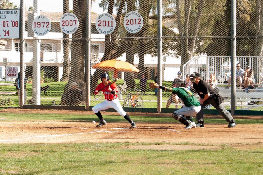 Vaquero Payton Milone (No. 8) hits a bunt down the third base line during the second game in a series of three versus Napa Valley, Saturday morning, Jan. 31 at Pershing Park, in Santa Barbara.