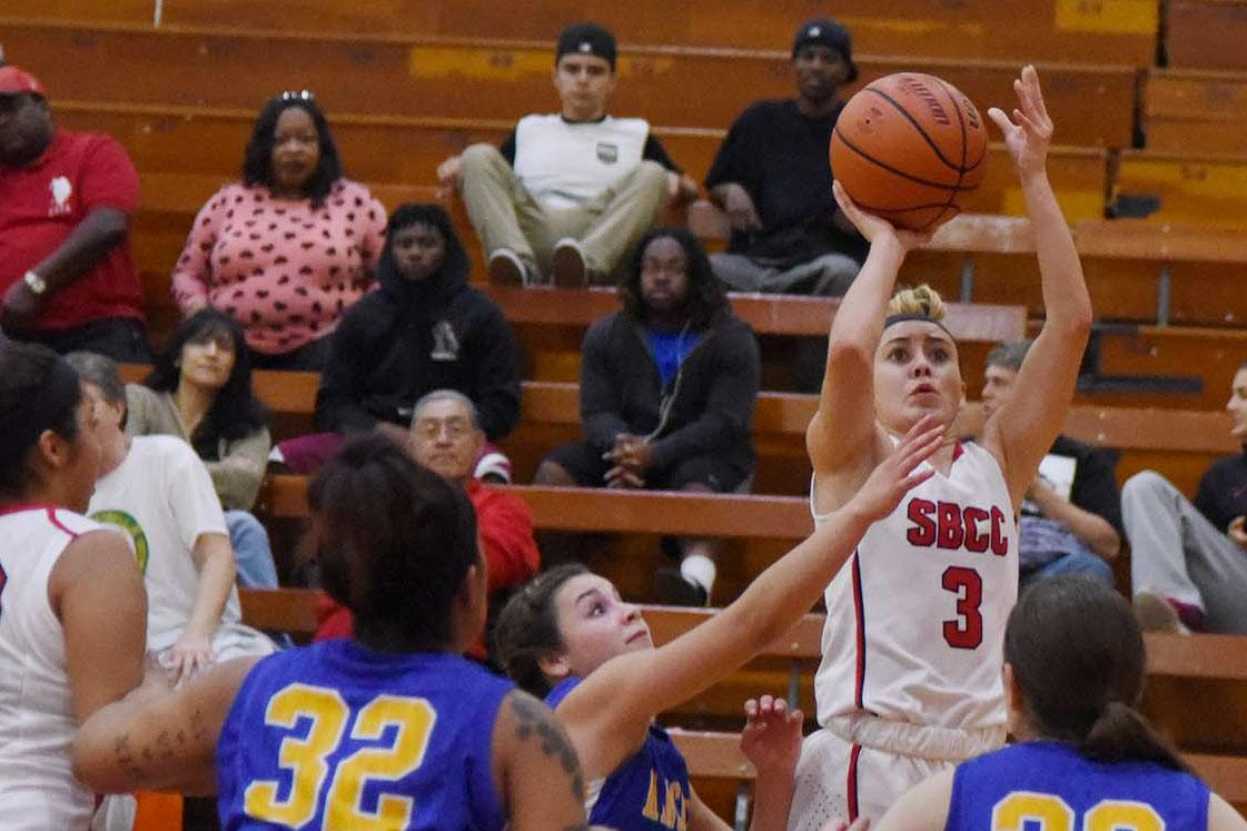 City College guard Mizhra Bautista (No. 3) makes a basket early in the second half while playing against Allan Hancock College, Wednesday, Feb. 18, in the Santa Barbara Sports Pavilion. City College beat Hancock 61-53 in its final home game of the season.