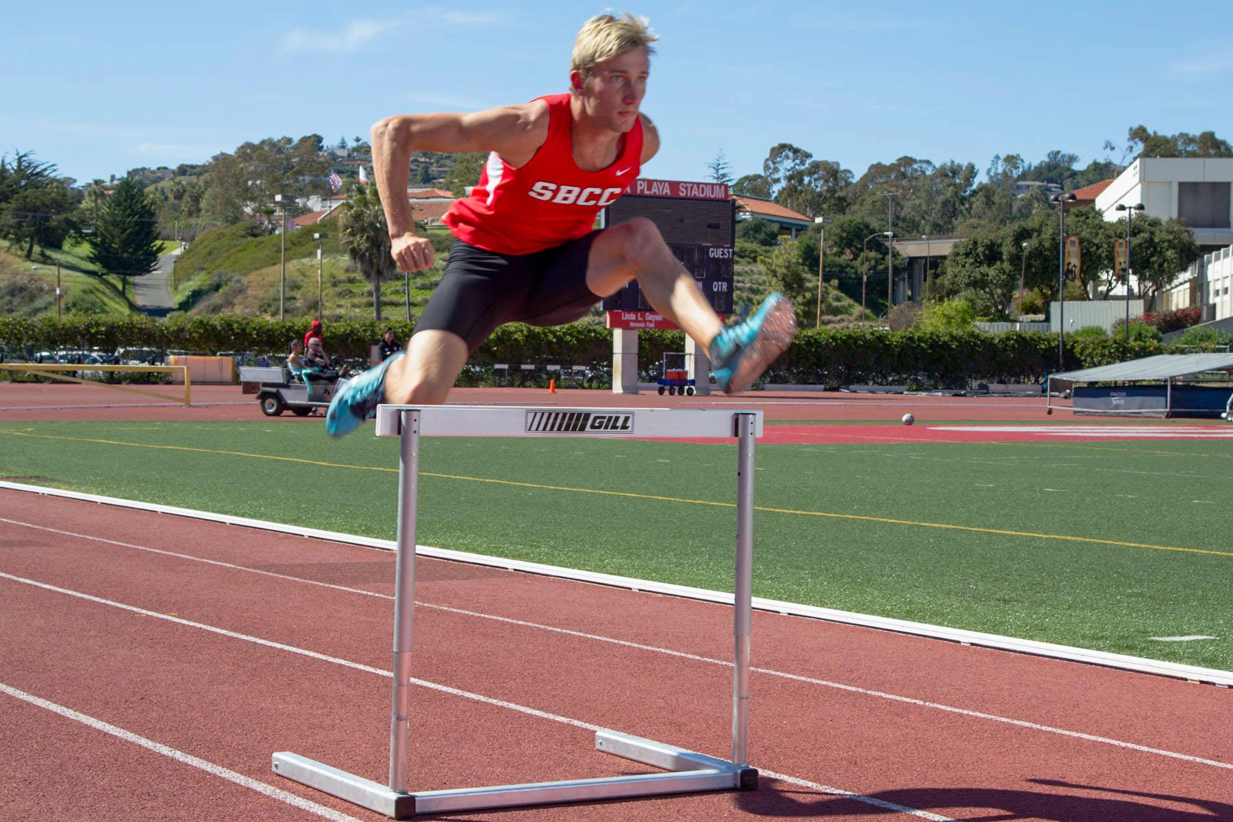 Bas Van Leersum is one of the leading athletes on the City College track team this year, as both a hurdler and a sprinter, Thursday, March 5, at La Playa Stadium in Santa Barbara.