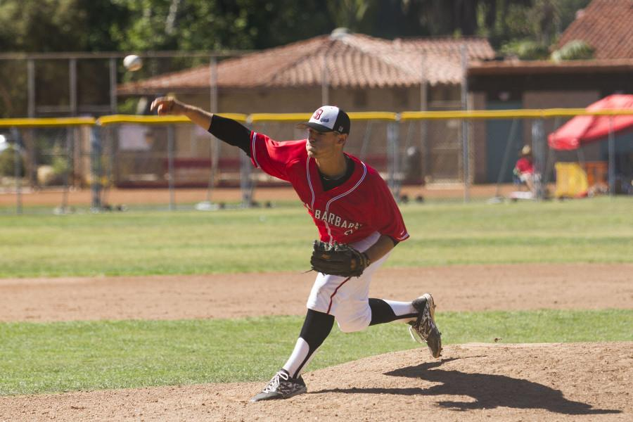 City College's Justin Bruce (No. 11) throws a pitch during the game against Allan Hancock College Saturday, March 14, 2015 at Pershing Park, Santa Barbara.