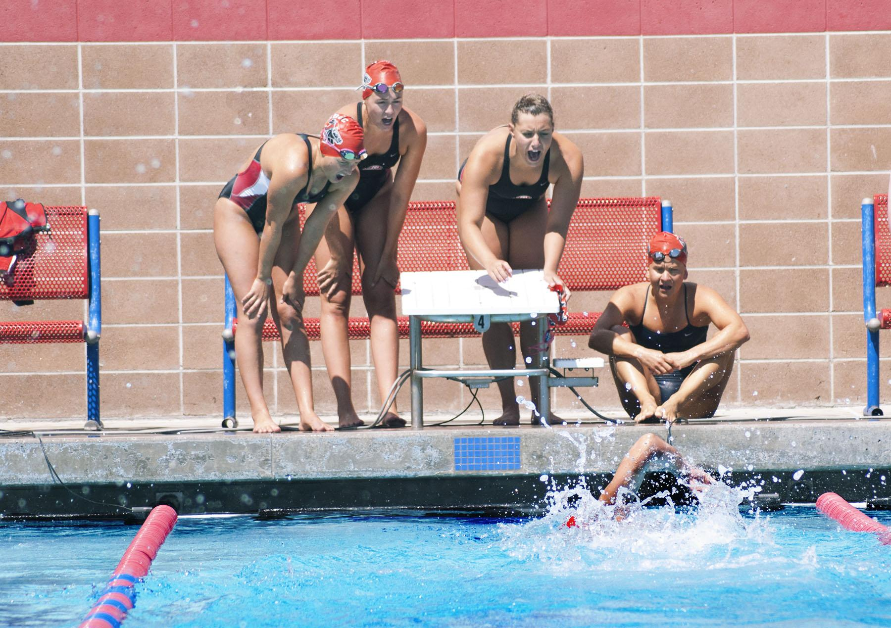 City College swimmer, Sarah Westmorelan, swims as anchor in the 4x100 yard freestyle relay while teammates (from left), Elise Hazel, Madelyn Brooks, Autumn Lovett and Katherine