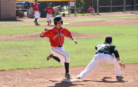 Spencer Erdman, (no. 5), beats out the throw to Cuesta College first baseman Kyle Raubinger, (no. 21), after a bunt down the third base line during the fourth inning at Pershing Park on Friday, March 27, 2015, in Santa Barbara, Calif. The Vaqueros scored 6 runs on four hits in the fourth inning.