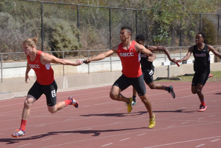 Tyler Higby receives the baton from Simon Bailey during the 4X100 meter relay event during the Santa Barbara Easter Relays at La Playa Stadium on Friday, March 20, 2015, in Santa Barbara Calif. The men won the 4X100 meter relay with a time of 42.18 seconds.