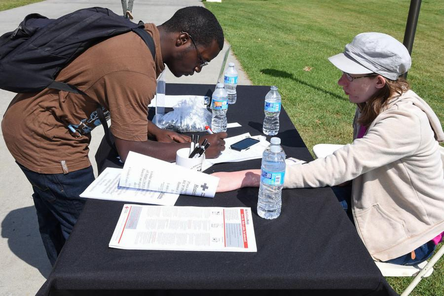 Radiology major Ricky Yarder, 23, signs up to join the Red Cross Club by its President Paulina Fisher, Wednesday, March 19, on City College's West Campus in Santa Barbara. The Red Cross Club was formed in Fall 2014 and is looking to be more active in the community.