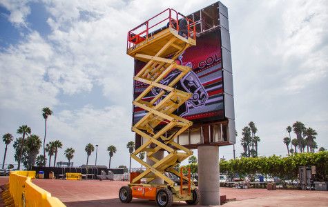 Workers assemble the new video scoreboard on Tuesday, Aug. 25, at City College's La Playa Stadium.