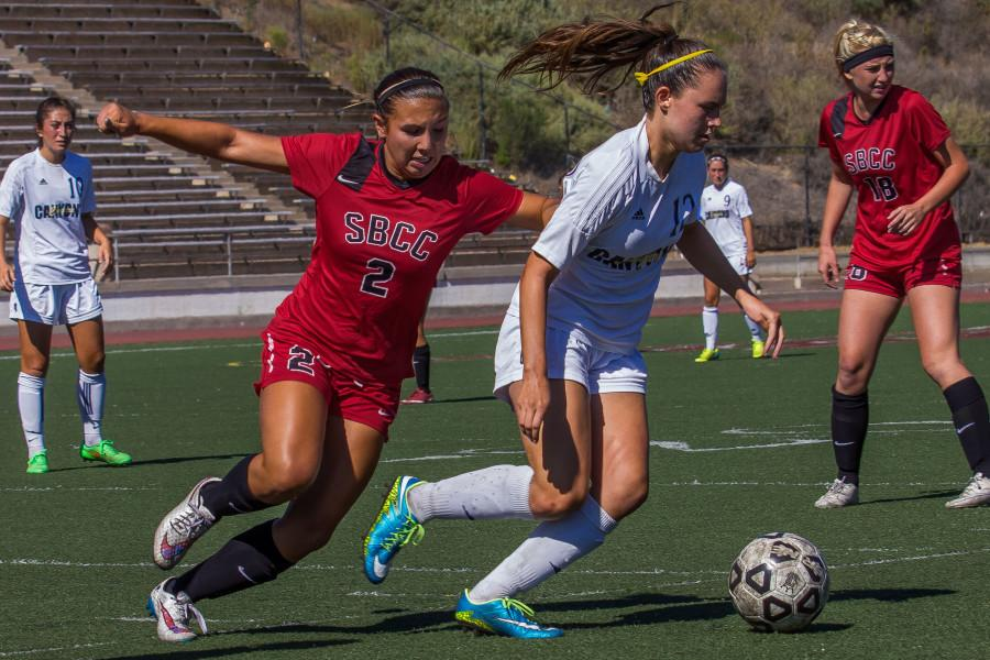 Vaqueros forward Blayne Shoffit (No.2) comes in to steal the ball successfully from Canyons defensive player Kailey Marquez (No. 12) during the first half of the match against College of the Canyons, Friday Sept 18, at La Playa Stadium. City College walked away with 1-0 for its fourth win of the season out of five games.