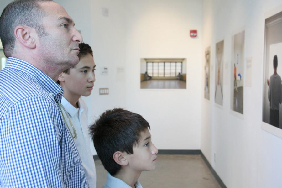 Doug Kottler (left), a former student of artist Richard Ross, is joined by sons Miles and Nathan, as they observe Ross's photographs on display at the 'Isolation' exhibit opening on Friday, Sept. 25, at the City College Atkinson Gallery, Santa Barbara.