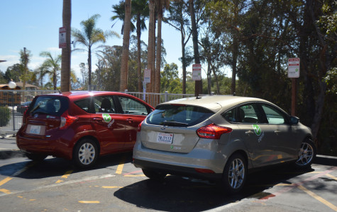 The two Nissan Versa Zipcars are parked outside the apartment complex Beach City on Wednesday Sept. 16, in Santa Barbara. The cars are rented through a mobile app or their website, with the minimum age of 18.