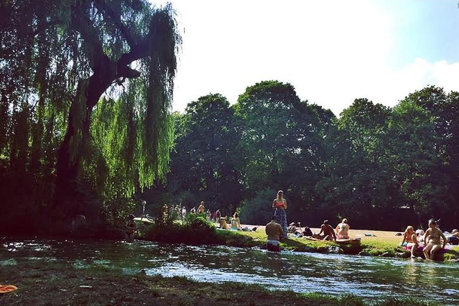 The Eisbach river flowing through the English Garten in Munich, Germany in August.